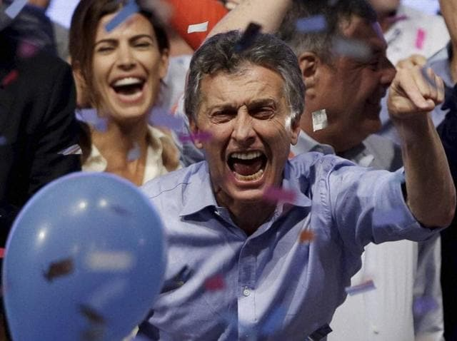 Opposition presidential candidate Mauricio Macri and his wife Juliana Awada, back left, celebrate after winning a runoff presidential election in Buenos Aires, Argentina.