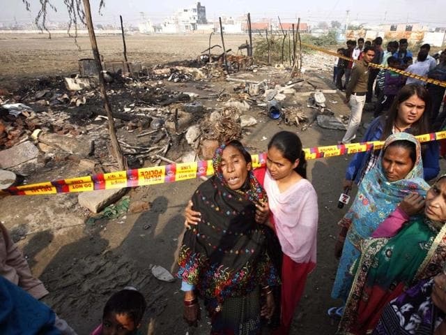Relatives mourn the death of five people at a slum in North-West Delhi's Bhalswa Dairy area.