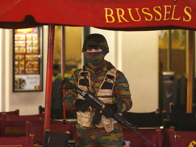 A Belgian soldier stands guard outside a cafe near Brussels' Grand Place.