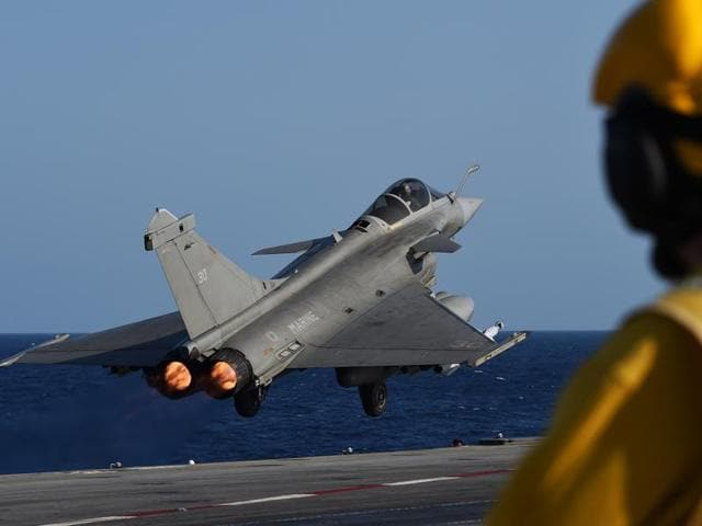 A French Rafale fighter aircraft takes off with bombs from the French aircraft carrier Charles-de-Gaulle, on November 23, 2015 at eastern Mediterranean sea, as part of operation Chammal in Syria and Iraq against the Islamic State (IS) group.