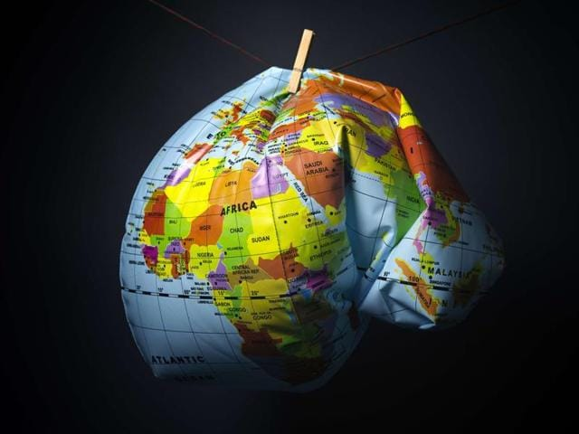 An illustration made in Paris on November 8, 2015 shows a deflated Earth globe. Earth has heated up by one degree Celsius (1.6 degrees Fahrenheit), Britain's weather office said on November 9, as greenhouse gases hit record levels just weeks before a crucial climate summit in Paris, which runs from November 30 to December 11.