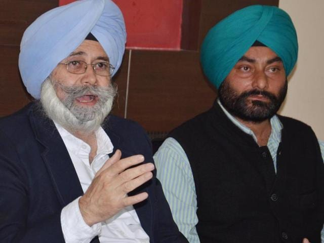 Former Aam Aadmi Party leader HS Phoolka(left) addressing a press conference.
