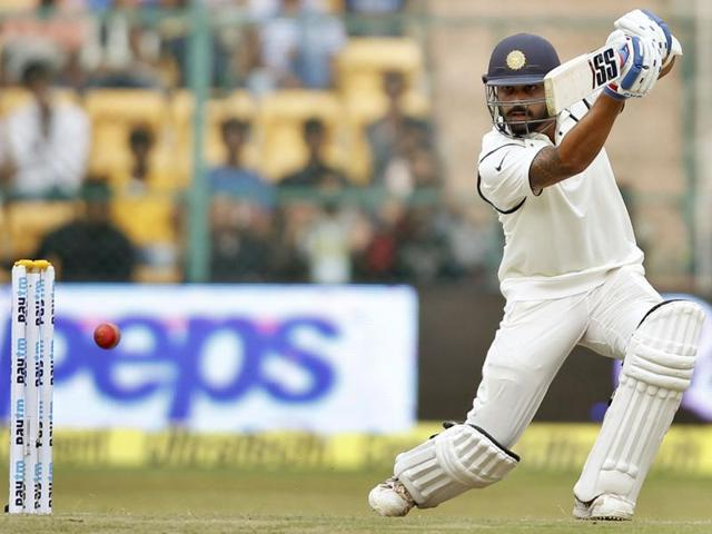 Indian opener Murali Vijay hits a shot during the second Test against South Africa in Bengaluru on November 14, 2015.