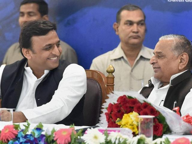 Samajwadi Party President Mulayam Singh Yadav and UP Chief Minister Akhilesh Yadav at a book release function in Lucknow on Saturday.