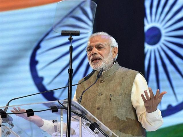 Prime Minister Narendra Modi addresses people from Indian community at an event in Kuala Lumpur, Malaysia, on Sunday .