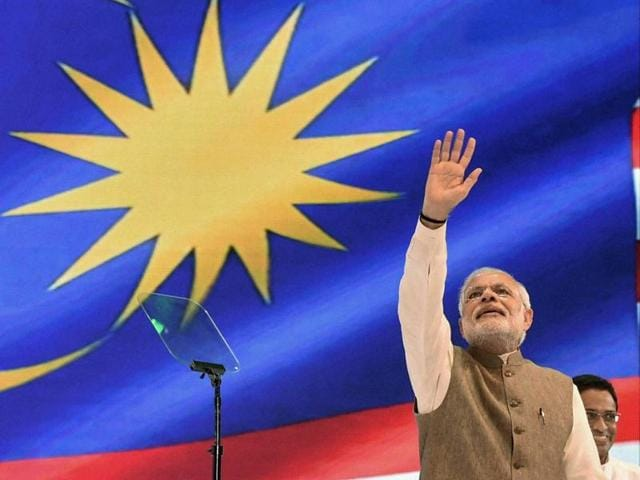 Prime Minister Narendra Modi waves to the Indian community during an event in Kuala Lumpur.