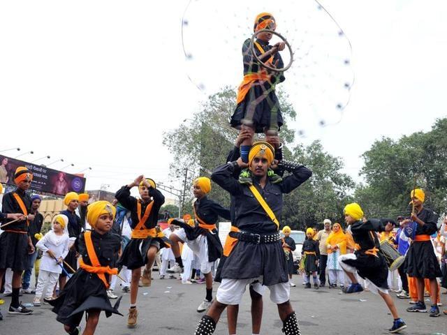 Sikh children rejoice during Prabhat Pheri on the occasion of Prakash parv of Gurunanak Dev in Indore on Sunday.