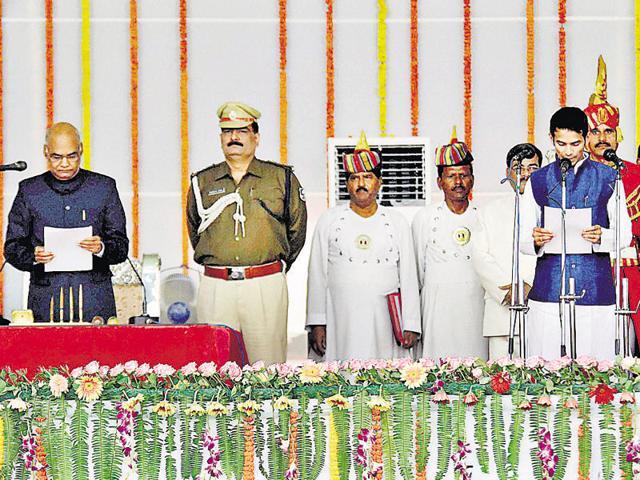 Tej Pratap (right) takes oath at the ceremony in Patna.
