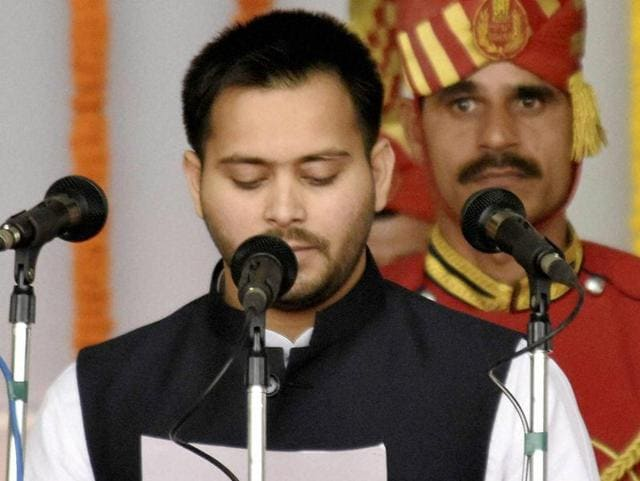 RJD chief Lalu Prasad's son Tejashwi Yadav takes oath as deputy chief minister of Bihar during the swearing-in ceremony on November 20.