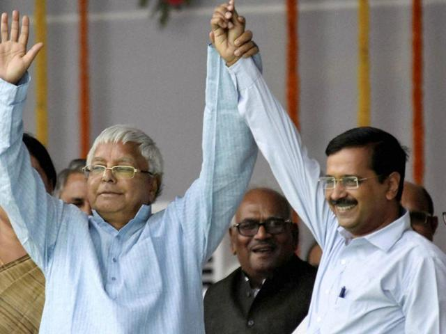 RJD chief Lalu Prasad with Delhi chief minster Arvind Kejriwal during the swearing-in ceremony of the new Bihar government at Gandhi Maidan.