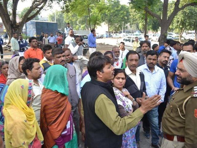 Relatives of bride sisters talking to cops in Sector 24, Chandigarh, on Monday.