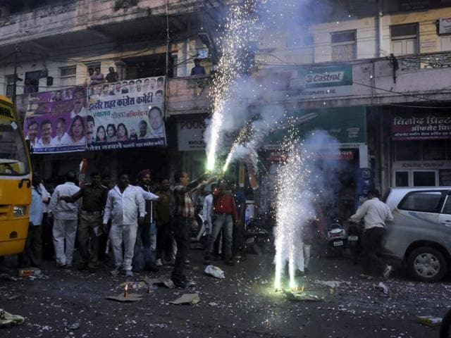 Congress workers celebrate party's win in Jhabua-Ratlam Lok Sabha by-poll, at PCC office in Bhopal on Tuesday.
