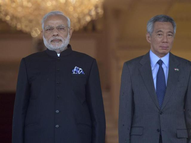 Indian Prime Minister Narendra Modi, left, and Singapore Prime Minister Lee Hsien Loong review the guard of honor at a welcome ceremony at the Istana or Presidential Palace.