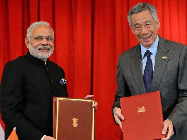 Prime Minister Narendra Modi (L) and Singapore's Prime Minister Lee Hsien Loong (R) pose after signing the Strategic Partnership Joint Declaration at Istana Presidential Palace in Singapore.