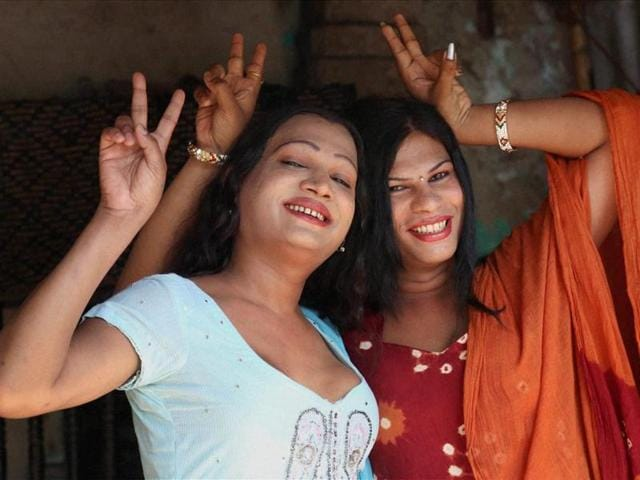 Two transgender people celebrate during a LGBT parade. A group of Delhi University students are arranging professional training courses for over 20 transgender people, with the goal of making them financially independent.