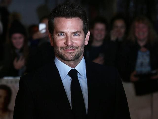 US actor Bradley Cooper poses as he arrives for the European premiere of the film Burnt in London.