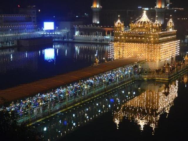 Golden temple illuminated with lights on the eve of Gurpurab.