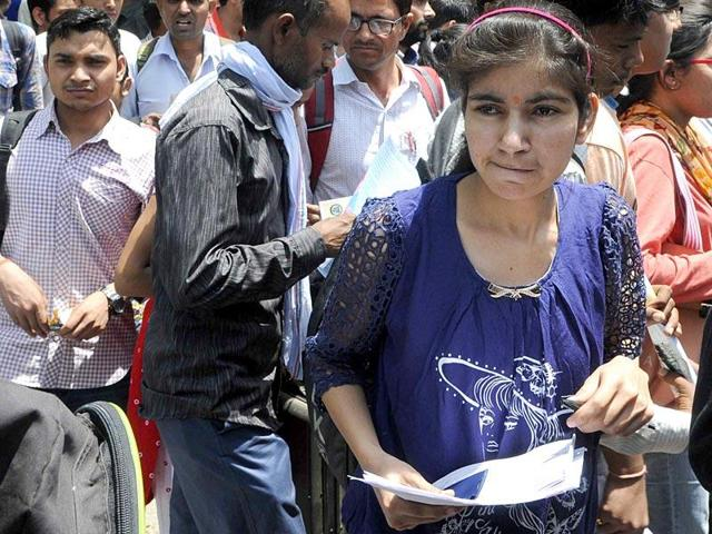 Students coming out of an examination centre after appearing for the All India Pre-Medical/Pre-Dental Entrance Test  in Jaipur, Rajasthan.