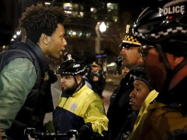 Chicago police scuffle with protesters in Chicago on Tuesday.