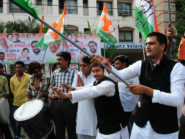 Congress workers celebrate their win in the Jhabua-Ratlam by-poll at the PCC office in Bhopal on Tuesday.