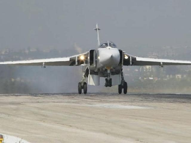A Sukhoi Su-24 fighter jet lands at the Hmeymim air base near Latakia, Syria, in this handout photograph released by Russia's Defence Ministry.