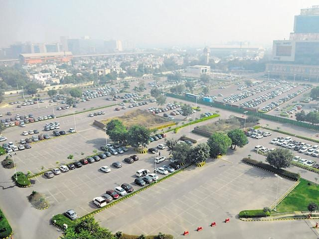 Very few cars were seen parked in the surface parking lot near Cyber Hub on the weekly car-free day observed on Tuesday.