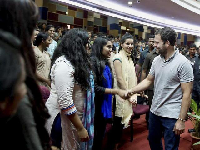 Congress vice president Rahul Gandhi greet students on his arrival at an interactive session with students of Mount Carmel College in Bengaluru.