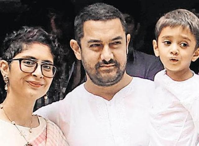 File photo of Aamir Khan, (C), with his wife, director Kiran Rao and son Azad. (AFP Photo)