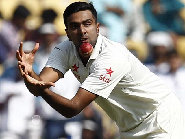 India's Ravichandran Ashwin takes a catch to dismiss South Africa's Morne Morkel.