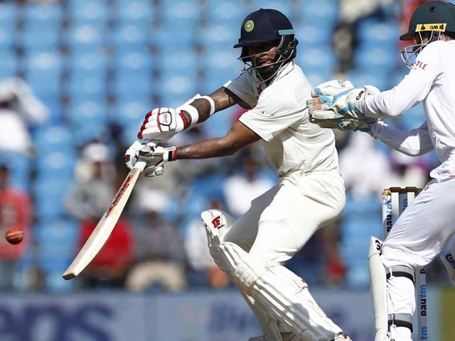 India's Shikhar Dhawan hits a shot during the second innings as South African wicketkeeper Dane Vilas watches.