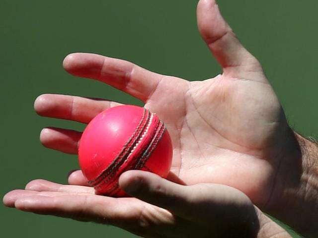 Austalia's Peter Nevill, right, reaches for a ball during training at the Adelaide Oval ahead of their cricket test against New Zealand.