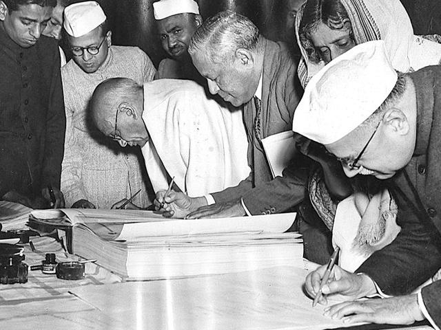 Jan 25, 1950: Key members of the Constituent Assembly sign the first copies of the Constitution.(HT Photo)