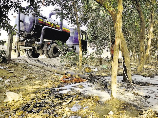 The Ghaziabad municipal corporation's sewer jetting machines dispose sewage into the green belt area near Vasundhara.