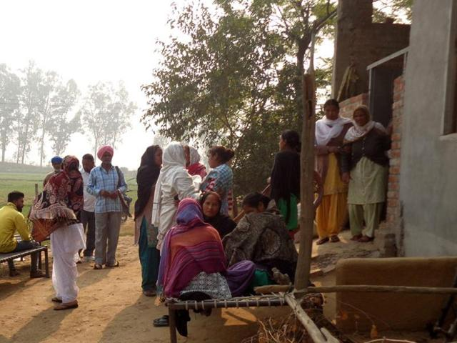 Relatives of Bachan Singh mourning outside their house in Dhaliwal Dona village after hearing about the accident.
