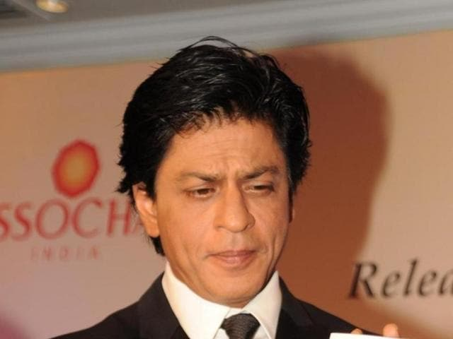 Shah Rukh Khan attends the launch of an ASSOCHAM (Associated Chambers of Commerce and Industry of India) coffee table book in Mumbai on November 23, 2015.