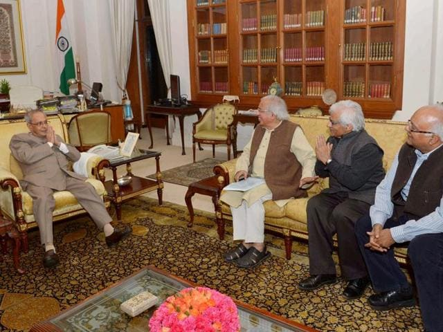 President Pranab Mukherjee during a meeting with Ashok Vajpeyi, Vivian Sundaram and Om Thanvi in New Delhi.
