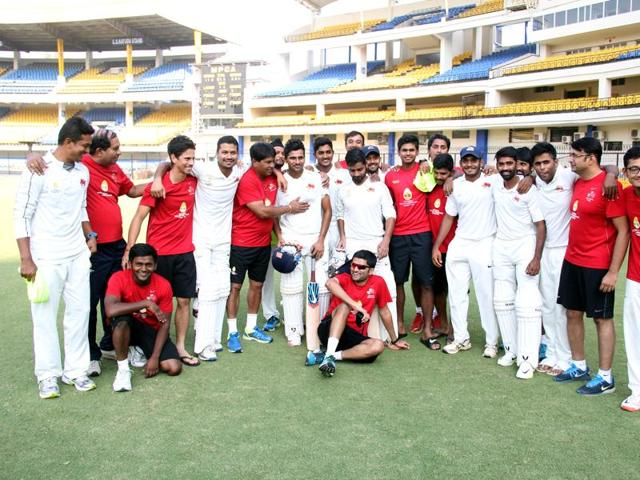 Cricketers exchange pleasantries after Mumbai scored a thrilling three-wicket win over Madhya Pradesh at the Holkar stadium in Indore on Wednesday.