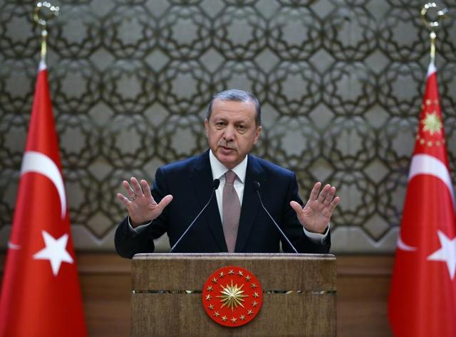 Turkey President Recep Tayyip Erdogan addresses a meeting of local administrators at his palace in Ankara. Turkey has released audio recordings of what it says are the military's repeated warnings to the pilot of the downed Russian plane before it was shot down.