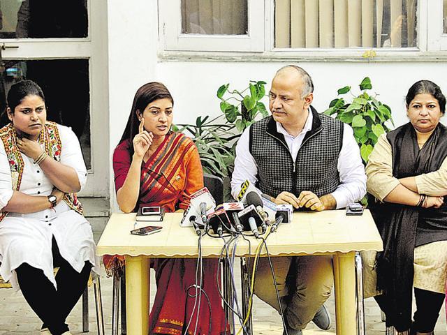 (L-R) AAP MLAs Parmila Tokas, Sarita Singh, Alka Lamba, deputy chief minister Manish Sisodia, Bhavna Gaur, deputy Speaker Bandana Kumari and Rakhi Birla address a press conference on Wednesday.