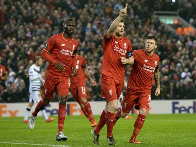 Liverpool manager Juergen Klopp, Alberto Moreno, Simon Mignolet and Kolo Toure celebrates at the end of the match against Bordeaux.