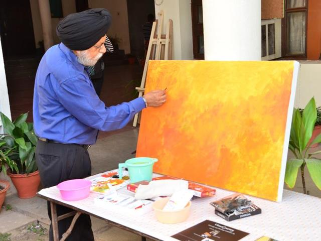 Artist Prem Singh paints in sunny yellow hues; (below) sculptor JS Patel at work on a sculpture at Punjab Engineering College in Chandigarh.