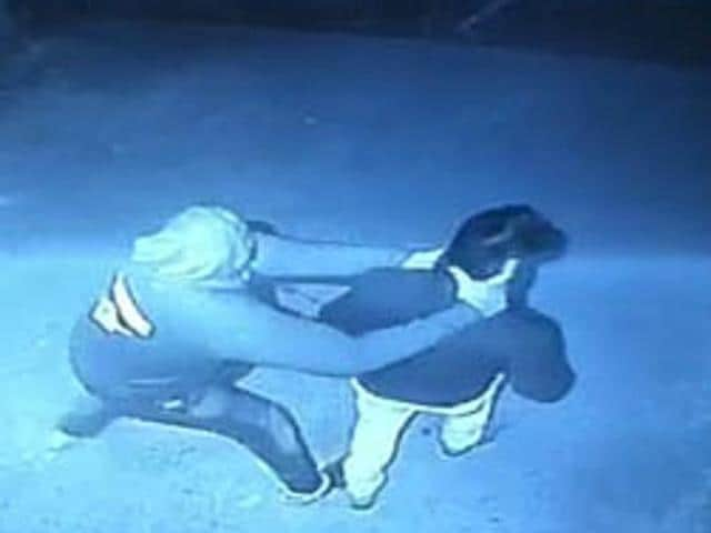A grab of the CCTV camera footage showing the manager of Miami Club in Sector 9 being beaten up