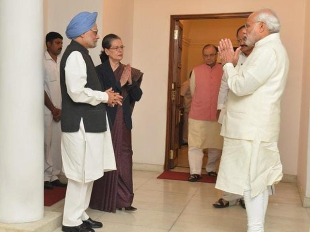 Prime Minister Narendra Modi with former prime minister Manmohan Singh and Congress president Sonia Gandhi during a meeting in New Delhi on Friday.