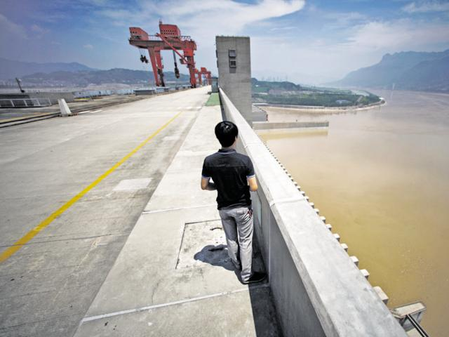 The largest dam India has built since Independence — the 2,000-megawatt Tehri Dam on the Bhagirathi — pales in comparison to China's giant projects, such as the 22,500-megawatt Three Gorges Dam (above) and the new Mekong mega-dams like Xiaowan.(REUTERS)