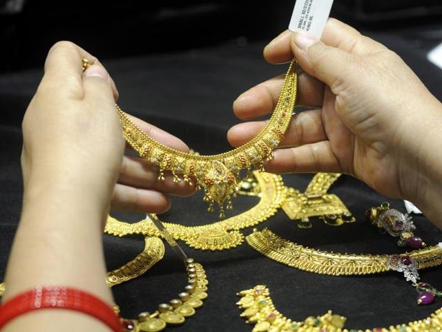 Gold was trading near its lowest in nearly six years on Thursday