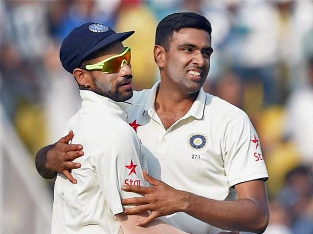India's captain Virat Kohli (L) and Ravichandran Ashwin appeal unsuccessfully for a catch against South Africa's captain Hashim Amla on the third day of the third Test in Nagpur on November 27, 2015.