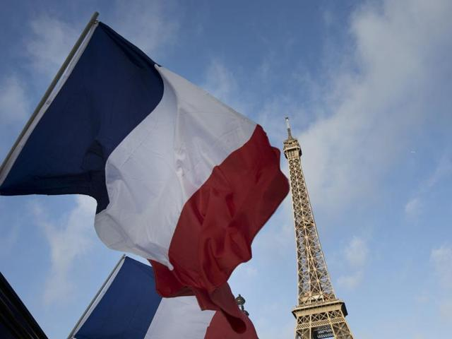 In this file photo, French flags fly in front of the closed Eiffel Tower on the first of three days of national mourning in Paris after the deadly attacks.