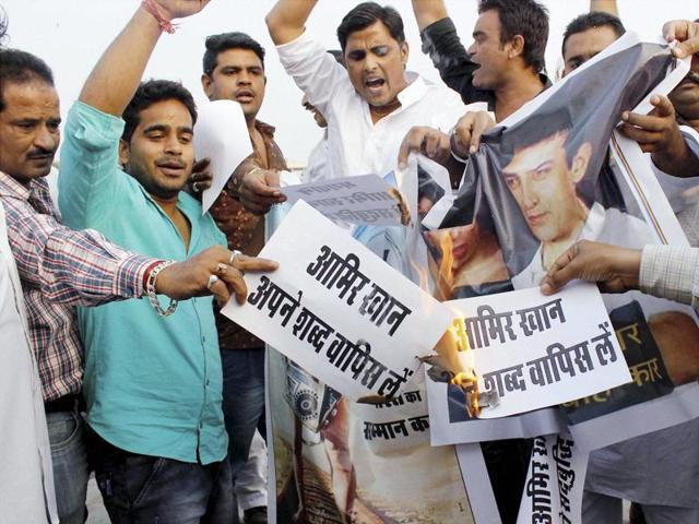 Youth display posters during a protest against actor Aamir Khan following his remarks over growing intolerance in the country in Jaipur on Thursday.