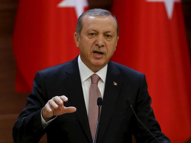 Turkish President Tayyip Erdogan makes a speech during his meeting with mukhtars at the Presidential Palace in Ankara, Turkey. Erdogan dismissed Russian reaction after downing of the plane as