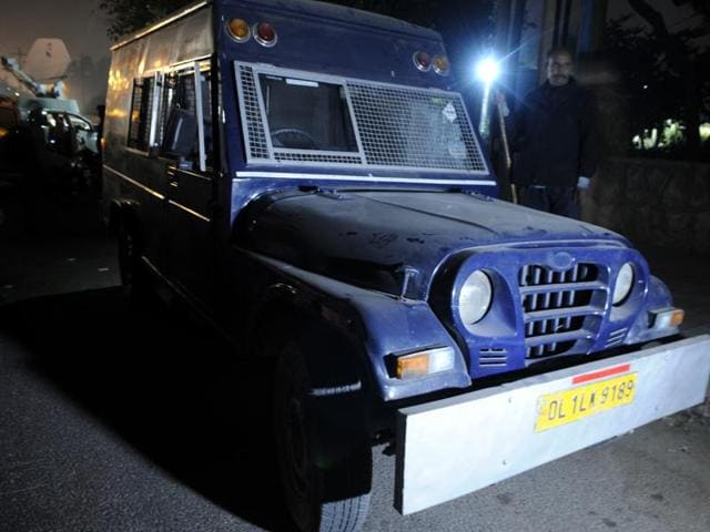 A cop stands near the van after its driver fled with Rs 22 crore.